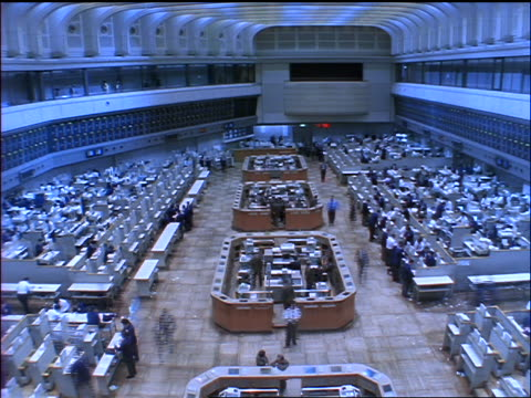 6d526d19f2 high angle wide shot time lapse people on floor of Tokyo Stock Exchange /  Japan