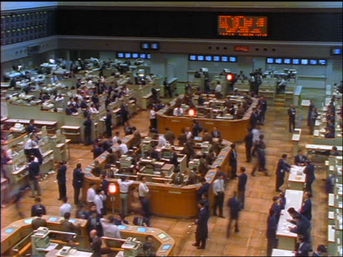 high angle wide shot time lapse people on floor of Tokyo Stock Exchange / Japan