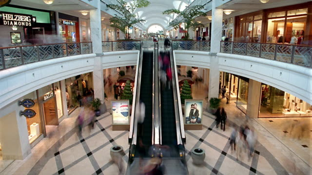 high angle wide shot time lapse people walking and using escalators in mall / atlanta, georgia - shopping centre stock videos & royalty-free footage