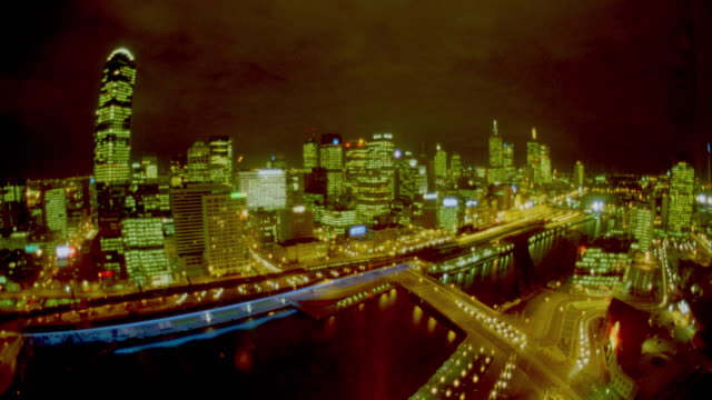 high angle wide shot time lapse traffic + clouds in front of melbourne skyline at night / victoria, australia - 1999 stock videos & royalty-free footage