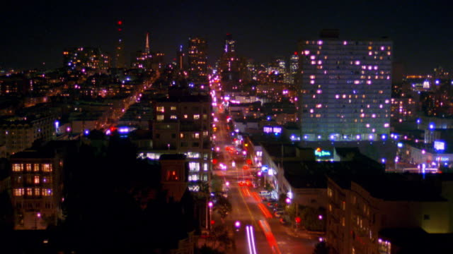 High angle wide shot time lapse traffic on city street at night / San Francisco, California