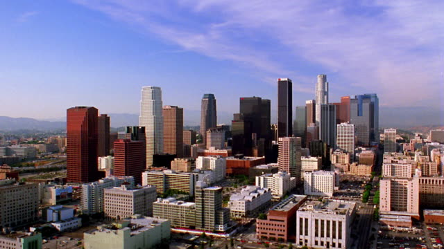 high angle wide shot time lapse traffic on city streets with buildings and skyscrapers in background / los angeles, california - 1993 stock videos & royalty-free footage