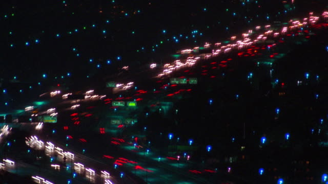 High angle wide shot time lapse traffic on highway at night