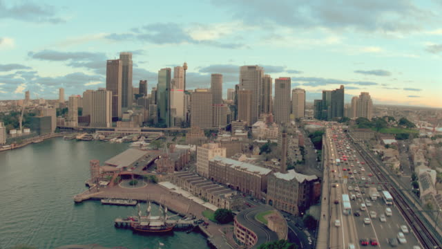 high angle wide shot time lapse traffic on highway + sydney city skyline / sydney, australia - lockdown stock videos & royalty-free footage