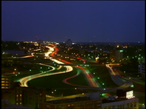 high angle wide shot time lapse traffic on highways and streets with buildings in background / dusk to night / minneapolis - dusk to night stock videos & royalty-free footage