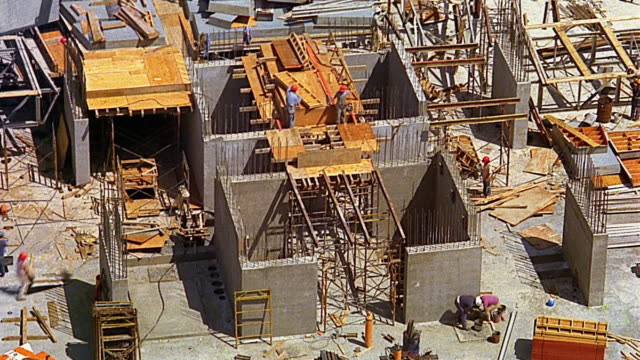 high angle wide shot time lapse workers at construction site - construction equipment stock videos & royalty-free footage