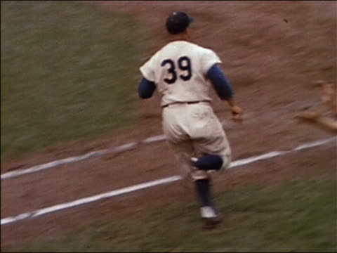 1957 high angle wide shot tracking shot Dodgers catcher Roy Campanella hitting a home run and rounding bases / Brooklyn