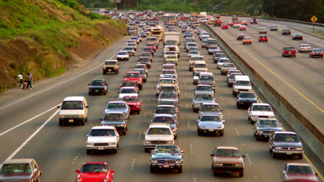 high angle wide shot traffic driving in traffic jam on highway / los angeles, california - 1980 stock videos and b-roll footage