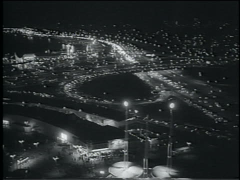 b/w 1964 high angle wide shot traffic on highway at night / new york city - 1964 stock videos & royalty-free footage