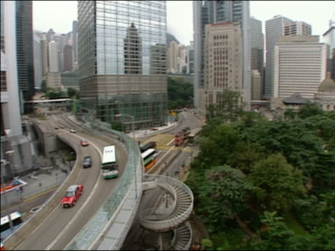 high angle wide shot trees and skyscrapers/ pan motorway and motorway junction/ hong kong - 2002 stock videos & royalty-free footage