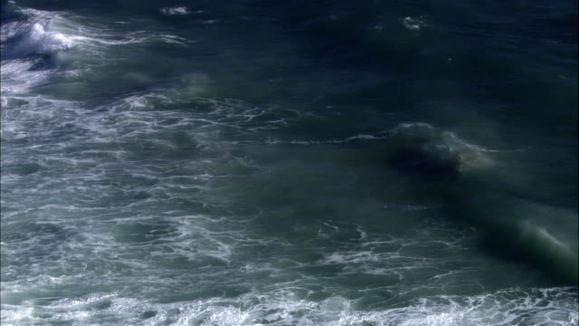 high angle wide shot waves crashing on rocky coast/ malibu, california - malibu stock videos & royalty-free footage