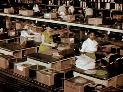1956 high angle wide shot women packing phonograph records in factory/ audio - prelinger stock videos & royalty-free footage