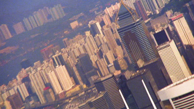 high angle wide shot zoom out buildings of downtown hong kong / china - bank of china tower hong kong stock videos & royalty-free footage