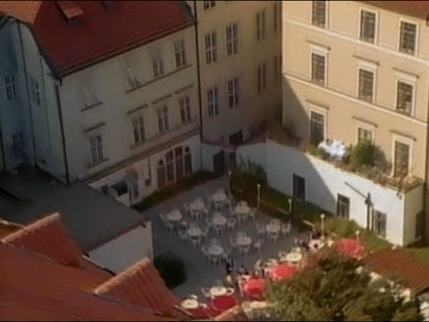 1994 high angle wide shot zoom out long shot from people dining at outdoor cafe to rooftops of city / prague / audio - 1994 stock videos and b-roll footage