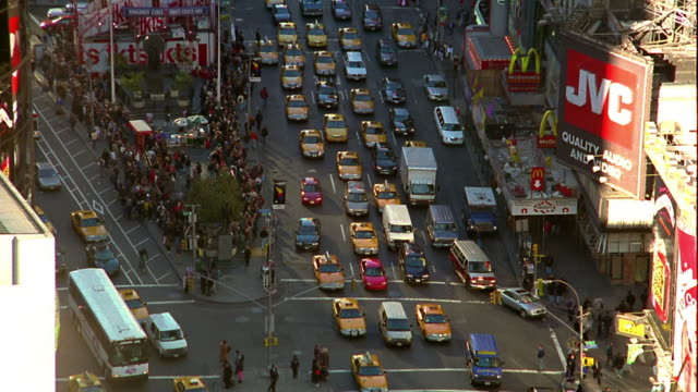 high angle wide shot zoom out traffic on broadway and 7th avenue in times square / midtown manhattan, new york city - broadway manhattan video stock e b–roll
