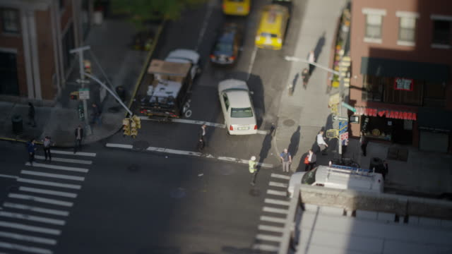 high angle wide time lapse shot of flagger directing traffic / new york, new york, united states - directing stock videos & royalty-free footage
