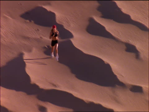 high angle woman in baseball cap jogging in desert - baseball cap stock videos & royalty-free footage