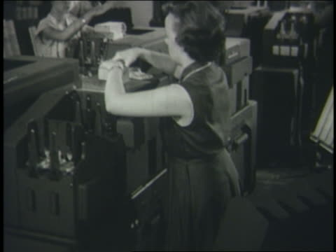 b/w 1950 high angle woman putting punch cards in computer - punch card reader stock videos & royalty-free footage