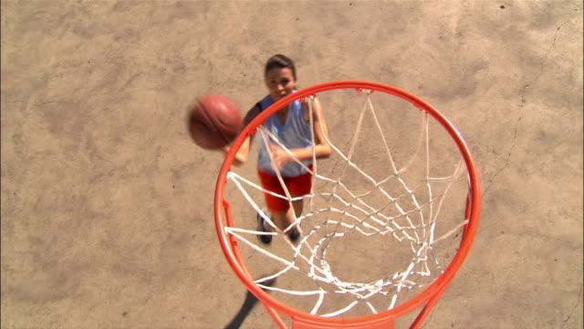 high angle woman shooting basket/ dallas, texas - shooting baskets stock videos & royalty-free footage