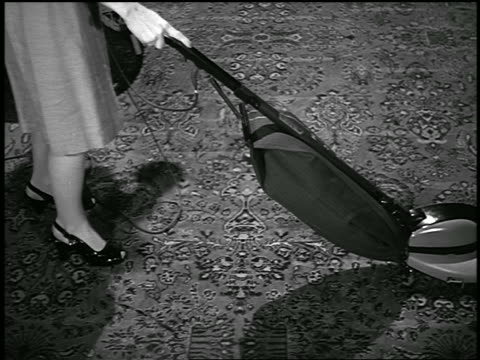 b/w 1945 high angle woman vacuuming oriental rug with hoover vacuum cleaner - cleaning equipment stock videos & royalty-free footage