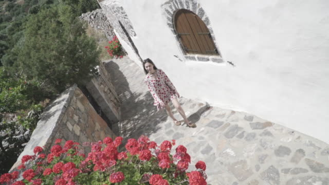 high angle, woman walks down stone pathway in crete - europe stock videos & royalty-free footage
