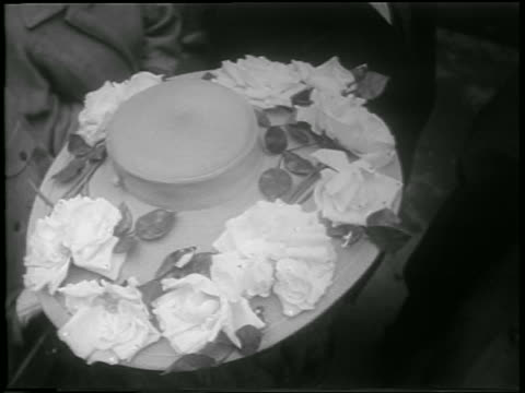 vídeos de stock e filmes b-roll de b/w 1952 high angle woman wearing easter bonnet looking up at camera + smiling / nyc / newsreel - 1952