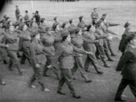 high angle women in uniforms marching in formation / syria / newsreel - 1957 stock-videos und b-roll-filmmaterial