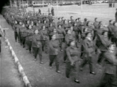 stockvideo's en b-roll-footage met b/w 1957 high angle women in uniforms marching in formation / syria / newsreel - 1957
