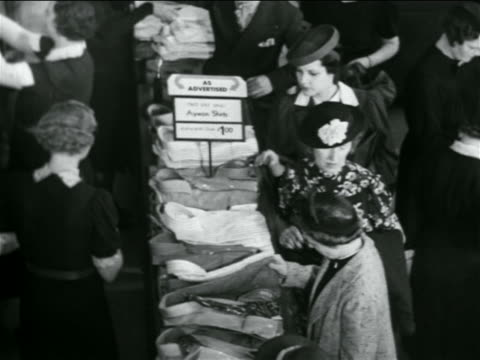b/w 1938 high angle women shopping at men's shirts counter in department store / industrial - department store stock videos & royalty-free footage