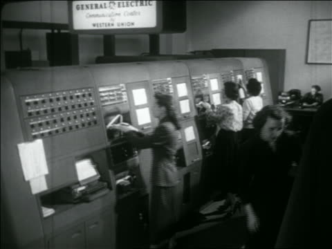 b/w 1956 high angle women working on large telegraph machines / western union - telegraph stock videos & royalty-free footage