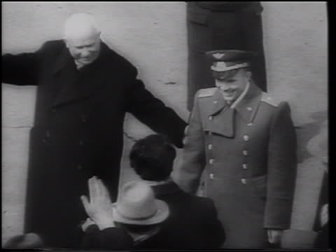B/W 1961 high angle Yuri Gagarin in uniform walking with Nikita Khrushchev outdoors