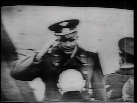 vídeos de stock e filmes b-roll de b/w 1961 high angle yuri gagarin saluting then kissing hugging nikita khrushchev after flight / on tv - 1961