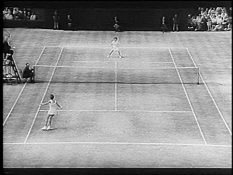 b/w 1966 high angle zoom in billie jean king maria bueno at wimbledon / king wins / newsreel - billie jean king stock videos & royalty-free footage