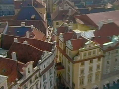 1994 high angle zoom in to rooftops and narrow street with pedestrians / prague - 1994 stock videos and b-roll footage