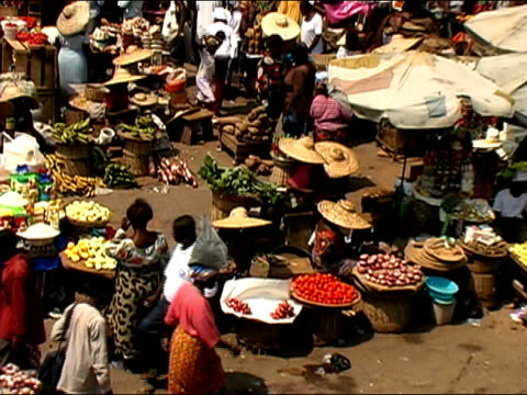 High angle zoom out busy outdoor market/ Ghana