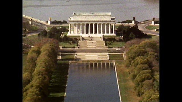 high angle zoom out from lincoln memorial; 1972 - reflecting pool washington dc stock videos & royalty-free footage