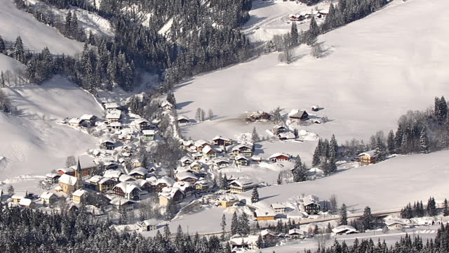 high angle zoom out from russbach ski resort in valley / austria - russbach stock videos and b-roll footage