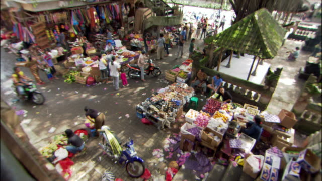 high angle zoom out marketplace in ubud / bali, indonesia - asian market stock videos and b-roll footage