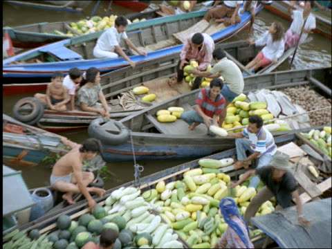 high angle zoom out men sell vegetables from boat to others in boats / floating marketplace / banjarmasin / borneo - kalimantan stock videos and b-roll footage