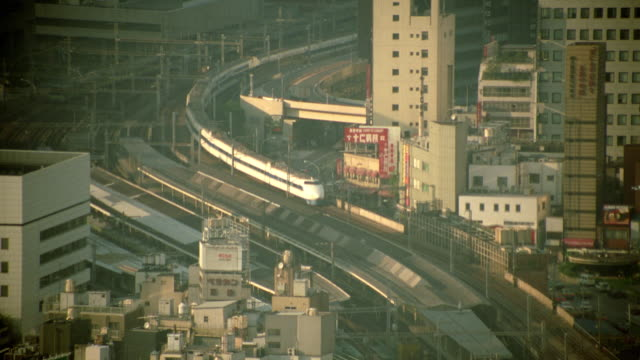 high angle zoom out of bullet train moving thru ginza, tokyo - ginza stock videos & royalty-free footage