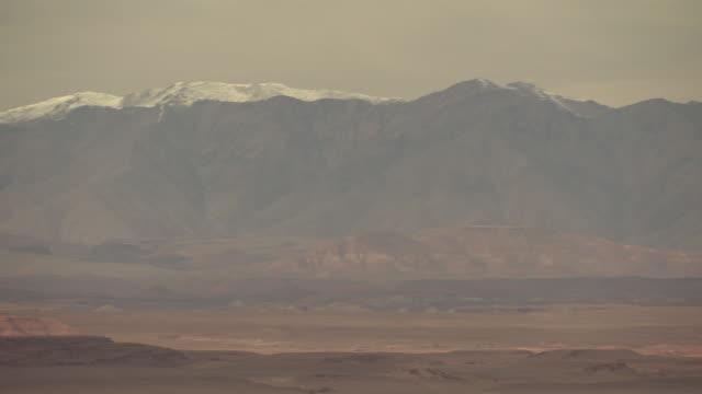 High Atlas landscape foothills w/ few snowcapped Atlas Mountains BG