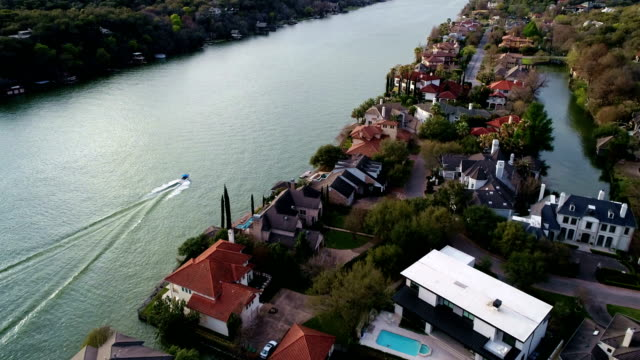 high contrast aerial view of boats and mansions along the colorado river at austin , texas , usa - high contrast stock videos & royalty-free footage