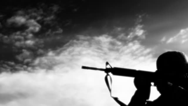 high contrast clip of soldiers practicing firing - in silhouette stock videos & royalty-free footage