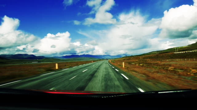 high contrast cloudy sky on iceland road trip - high contrast stock videos & royalty-free footage