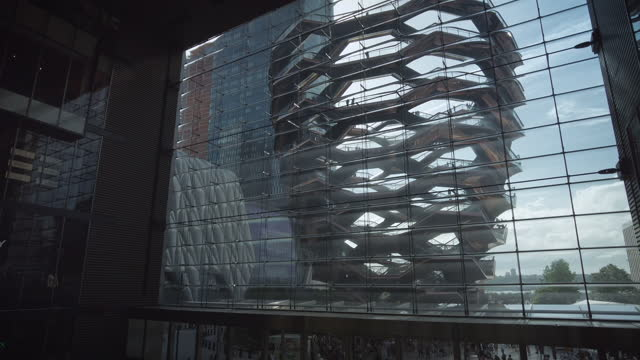 """high contrast """"the vessel"""" landmark in hudson yards view from inside the hudson yards mall with no people. filmed on june 26, 2021. - high contrast stock videos & royalty-free footage"""