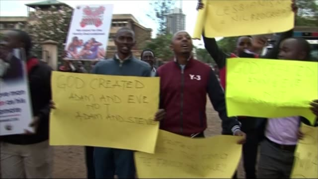 high court decides against decriminalising homosexuality kenya nairobi ext people opposed to changing the law protesting with placards - homosexual stock videos & royalty-free footage