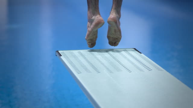 high diver jumping into the water - sports training stock videos & royalty-free footage