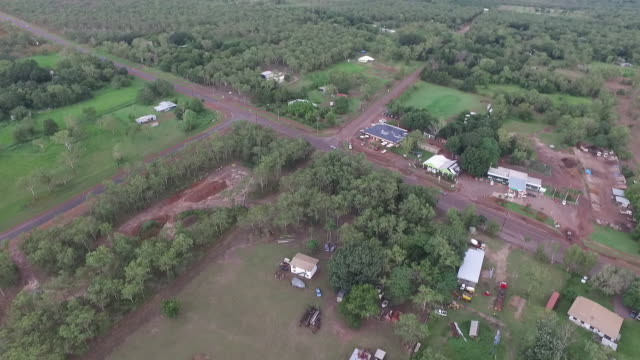 High drone aerial over Dumpty Doo moves over Hotel and Bottle Shop also seeing service station Arnhem Highway and bushland stretching to the horizon...
