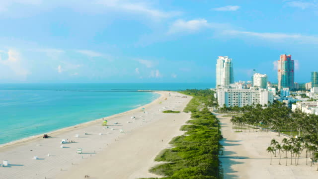 high drone view over south beach in miami beach, florida, usa - オーシャンドライブ点の映像素材/bロール