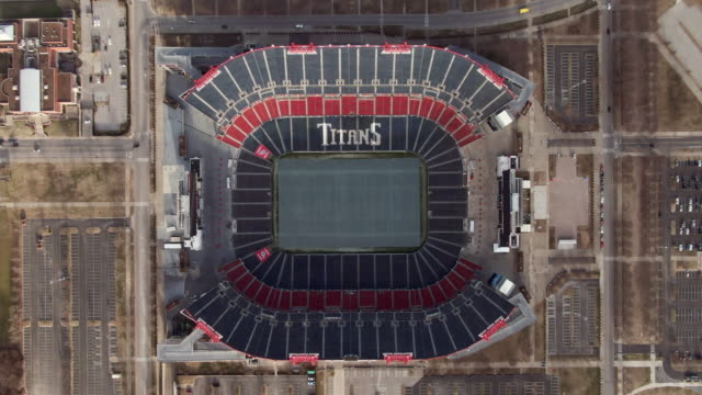 high elevation aerial ascending: nfl stadium in nashville on sunny winter day - tall high stock videos & royalty-free footage